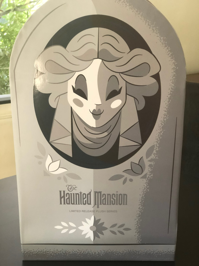 The back of the box (starring Madame Leota) containing the Haunted Mansion limited release plush series Hatbox Ghost and Bat