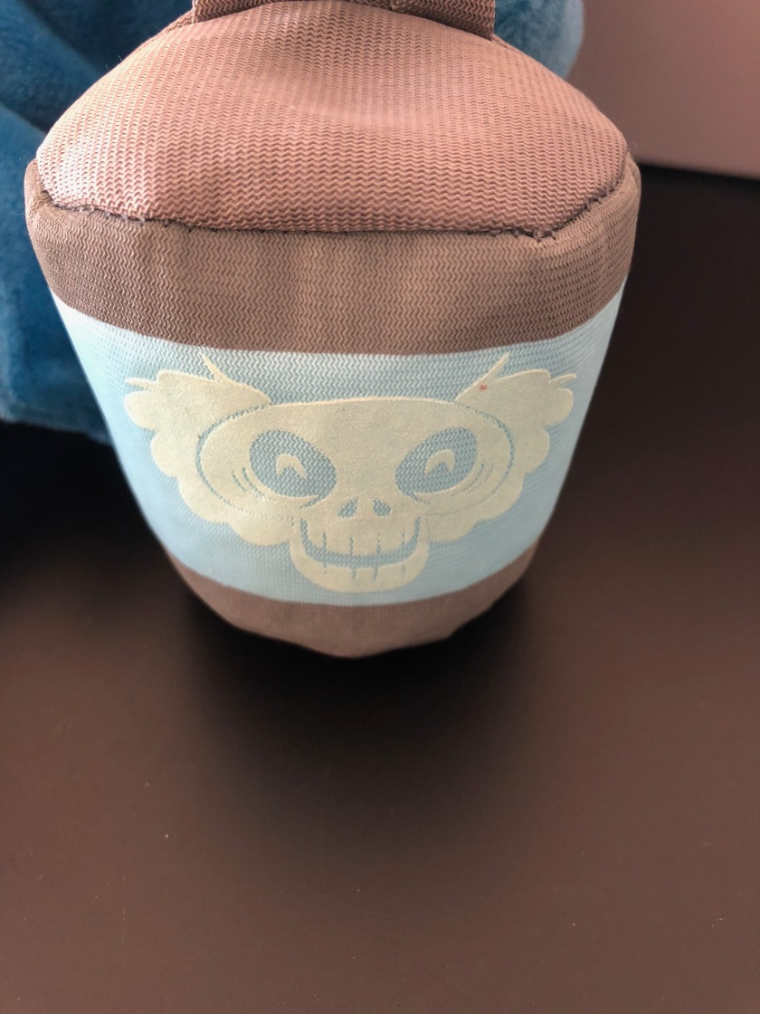 The detail on the Hatbox Ghost's hatbox from the Haunted Mansion limited release plush series